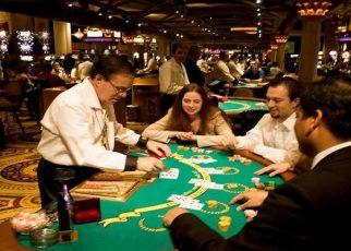 Blackjack table in Las Vegas, Nevada, Caesars Palace and Casino, gaming, gambling, chips, blackjack, betting croupier, blackjack players, model released, blackjack table, cards, NV, Las Vegas, Photo nv239-17139. Copyright: Lee Foster, www.fostertravel.com, 510-549-2202,lee@fostertravel.com